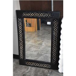 Framed wall mirror in fretwork style frame