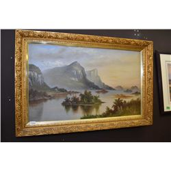"Gilt framed oil on canvas painting of a mountain and lake scene, 21"" X 34"""