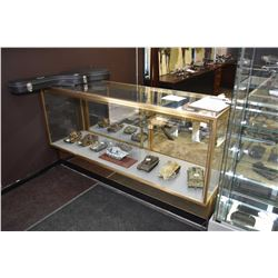 "Counter style retail display cabinet with sliding doors and adjustable shelves, 70"" long"