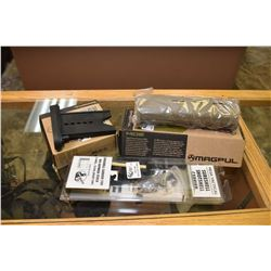 Two new in package Magpul accessories including Mag 318-BLK 870 butt pad adapter and a Mag 491-FDE f