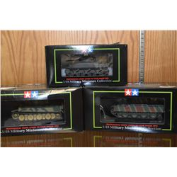 Three new in package 1:48th scale military miniatures tanks including M 4A1 Sherman, German Panther