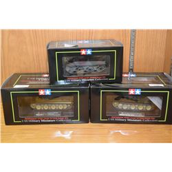 Three new in package 1:48th scale military miniature tanks including M 4a1 Sherman, German Panther T