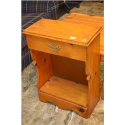Two pieces of knotty pine furniture including single drawer console and a coffee table