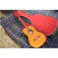 Saturn acoustic guitar in hard case