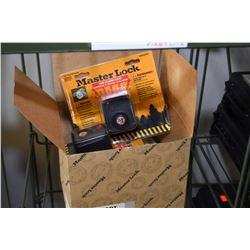 Box of four new Masterlock gun locks with motion alarms