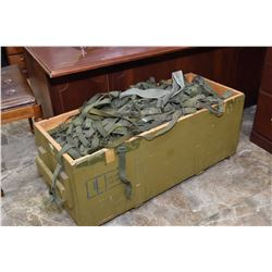 Wooden military box full of suspenders and belts
