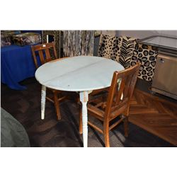 Primitive painted dining table and two oak chairs