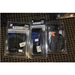 New in package Uncle Mike's left hand holster, Black Hawk double mag pouch and flashlight pouch