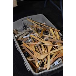 Large tub of wooden hangers including pants and coats style