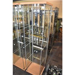 """Free standing column style display cabinet with single door and three glass shelves, 64"""" in height"""