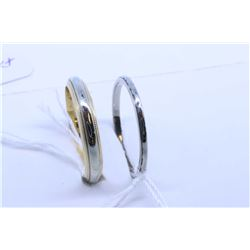 Two ladies 10kt gold bands including white gold band and two toned yellow and white gold band