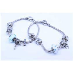 Two genuine Pandora sterling silver bracelets with thirteen Pandora charms