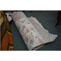 """Large sculpted carpet in soft tones of cream, blues, peach etc. 110"""" X 144"""""""