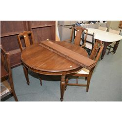 Round quarter cut oak Canadiana dining table with three leafs and three dining chairs