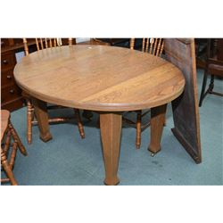 Heavy Mission influenced oak four leg dining table with large insert leaf