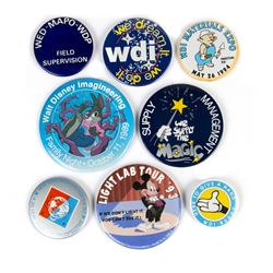 Collection of (8) Imagineering Buttons.