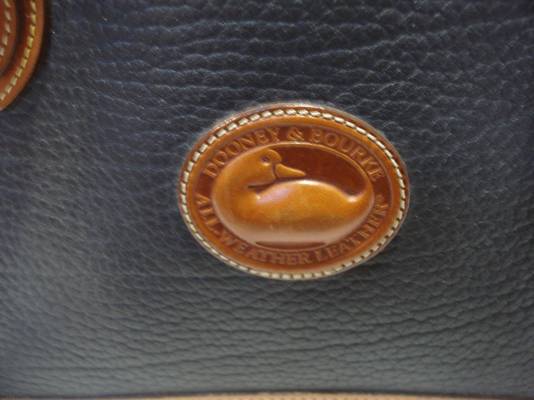 dooney and bourke serial number starting with a