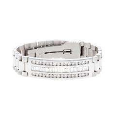 BRACELET: [1] 14kt white gold diamond bracelet; Italian president style bracelet set with (32) round