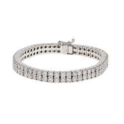 BRACELET:  [1] 14 karat white gold bracelet set with 104 round brilliant cut diamonds, approx. 25.00