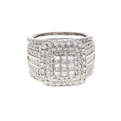 RING: 14k white gold ring, size 8.5; (9) princess cut diamonds, 2.2mm-2.3mm = an estimated 0.60 tota