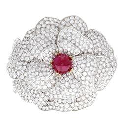BRACELET: (1) 18KWG bracelet, ''Kwiat'' floral design cuff, 11.0mm cab ruby 7.00 cts. TWA, 375 rbc d