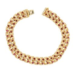BRACELET: [1] 18ky tested bracelet; 8 inches long; (64) imitation ruby; (202) rb diamonds, 2.0mm-2.4