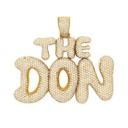 "PENDANT: [1] 10k yellow gold ""The Don"" pendant; (1205) round brilliant cut diamonds, 1.1mm-1.6mm = a"