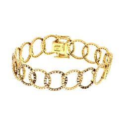 BRACELET: 18k yellow gold bracelet; 7 inches long; (363) round brilliant cut diamonds, 1.2mm-1.3mm =