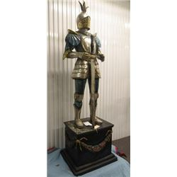 "SCULPTURE: Bronze Knight in armor, holding sword, standing on painted base. 80"" H on base 22"" x 29"""