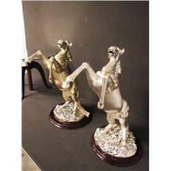SCULPTURE: Pair of silver rearing horses on wood bases. No markings found noted on previous report.
