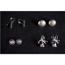 A set of four pairs of earings