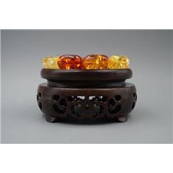 An Amber Barrel Beads Bracelet.