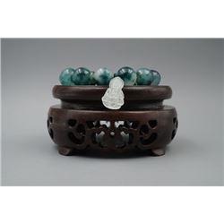 A Round Beads Bracelet with an Avalokitesvara Pendant.