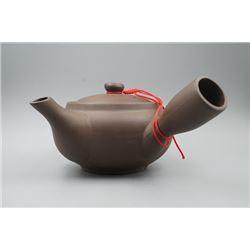 A Purple Clay (Zisha) Teapot.