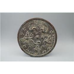 """A """"Ge Wu Sheng Ping"""" Pattern Bronze Mirror."""