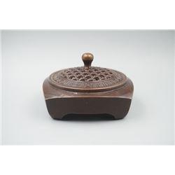"""A """"Qian Long Nian Zhi"""" Mark Bronze Handwarmer."""
