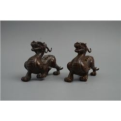 A Pair of Old Auspicious Beast Decoration.