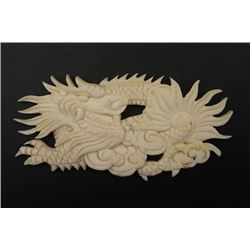 "A Natural Material Carved Decoration in a ""Dragon"" Pattern."