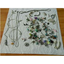 BAG OF ASSORTED JEWELRY - EARRINGS(MIXTURE) & MORE