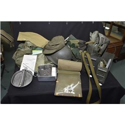 Selection of military surplus including cookware, helmet, boot liners, thermos, document pouch, heat