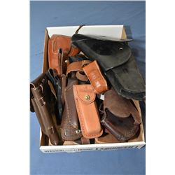 Selection of leather goods including holsters and knife scabbards
