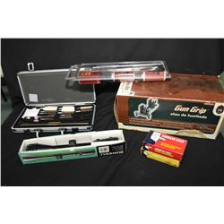 Selection of gun accessories including Gun Grip brand shooting rest in original box, two gun cleanin