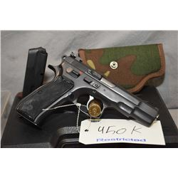 Restricted CZ 85 9mm mag fed semi-automatic pistol, fixed front sight, adjustable rear, checkered pl