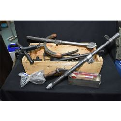 Selection of collectible military gun parts including barrels, handles etc.