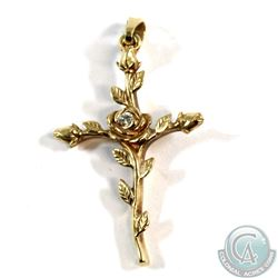 Floral Cross Pendant fashioned in 14-karat Yellow Gold, 3.6g. Decorated w/ leaves and buds with rose