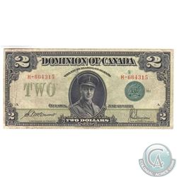 DC-26d 1923 Dominion of Canada $2, Green Seal 1. S/N: H-664315/A. Note is VF condition with some wax
