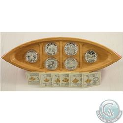 RCM Issue; 2015 $10 Canoe Across Canada.999 Silver 6-coin Set & Deluxe Canoe coin holder on a stand