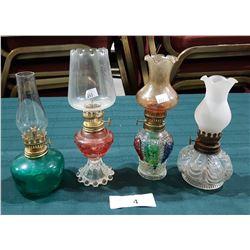 FOUR VINTAGE OIL LAMPS