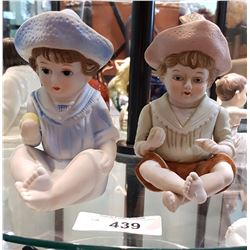 TWO ANTIQUE GERMAN PORCELAIN FIGURINES OF CHILDREN