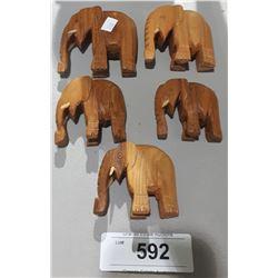 FIVE CARVED WOOD ELEPHANTS